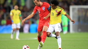 England's Harry Kane (right) and Colombia's Juan Cuadrado
