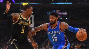 Los Angeles Lakers guard Kentavious Caldwell-Pope and Oklahoma City Thunder forward Paul George